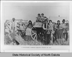 Metis family with Red River carts, 1883  State Historical Society of North Dakota (A4365)