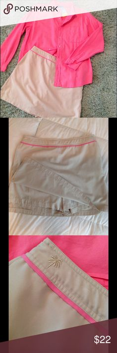 """Lilly Pilitzer kakhi/pink golf/everyday skort 12 Super comfortable for golf or everyday!  Easy care polyester. Fun pink detail at waist. Signature embroidered 'Lilly' Palm on waistband! Hidden side zip. Large side pockets.  Back pocket.  Hidden elastic and buttons for perfect fit. Measures 17"""" across waist. 17""""s long.  (Seen with New 'Fresh Produce pink blouse!) Lilly Pulitzer Skirts Mini"""