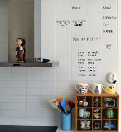 """""""Boring"""" wall tiles enlivened with a whiteboard marker"""