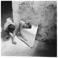 Francesca Woodman  (What a strange girl she was... and a vrey strange feeling of understanding without words pervades me when I see her work)