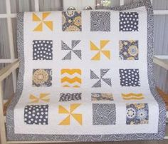 Baby quilt in yellows, grays, and cream square and pinwheel block. via Etsy by Susz