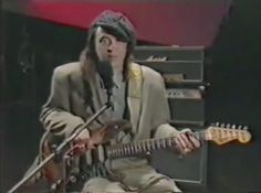 """In this classic video, Stevie Ray Vaughan shows how he plays 3 of his tunes - """"Hideaway"""", """"Rude Mood"""", and """"Superstition"""" - after a quick sit-down interview with a reporter."""