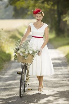 View our range of affordable tea length wedding dresses from Brighton Belle. Featuring vintage 50's style short bridal gowns & unique retro t-length wedding dresses. #vintageweddingdresses