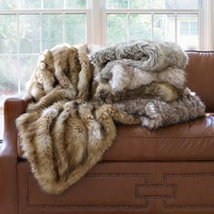 Faux fur throw lap blanket. Click through to see all the print options.