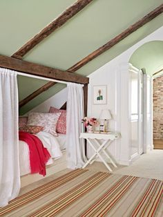 Create a private hideaway with a simple tension rod and curtains. This super cozy sleeping nook, framed by the home's original wood beams features bedding by John Robshaw, complimented by a striped rug from Dash & Albert.    Read more: Bedroom Design Ideas – Guide to Bedroom Design - Country Living