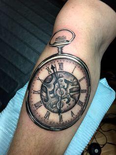 Pocket watch tattoo by Audrey Mello