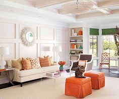 We love to add architectural elements like the coffered ceiling and walls. It creates enough detail in the space to leave the rest of the room simple and neutral. Color is added back with bold Ottomans and accessories for lived in yet stylized room.