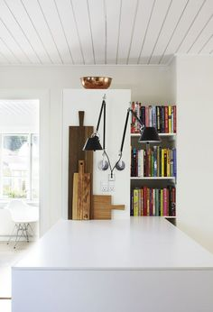 Artemide tolomeo wall lamps in the kitchen.