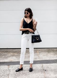Talisa Sutton pairs these black leather loafers with white jeans and a black tank top for a gorgeously contrasting outfit which is sure to give you a sophisticated style. Loafers are also especially effective worn with cropped or rolled jeans! Camisole/Jeans: Grana, Bag: J.W Anderson, Loafers: Gucci.