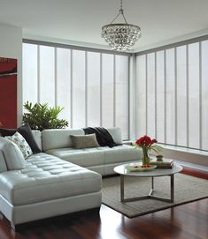 White, a classic no-fail choice for this living room. Skyline® Gliding Window Panels ♦ Hunter Douglas window treatments #Apartment