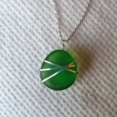 Wire wrapped green glass pendant from Sprite bottle