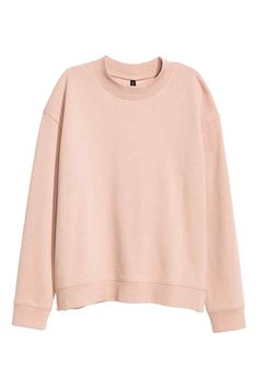Sweatshirt: Top in sweatshirt fabric in a relaxed fit with dropped shoulders, long sleeves and ribbing at the cuffs and hem. Soft brushed inside.