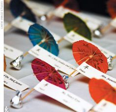 Minnie changed out of the vibrant Asian wedding wear she donned for the tea and joined guests amid long tables numbered with Chinese characters that included happiness, love,  and health. Colorful cocktail umbrellas served as place cards, while floating wa...
