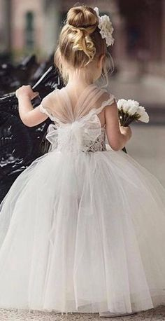 weddedwonderland.  We absolutely adore this little angel in her mini princess gown!