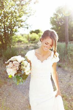wedding gown with sleeves & a scalloped neckline