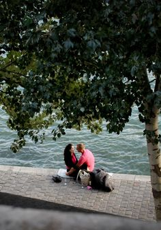 A boy, a girl, wine (real glasses!) on the banks of the Seine, Paris.  Sigh