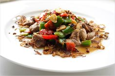 Stir-fried Pork with Cincaluk (Heh Ya Kay Char Bak) recipe - While cincaluk is not everyone's cup of tea, for those who love it, it lends a very distinct and exotic flavor to the main ingredient, in this case, pork. The generous use of green bell peppers, red chiles, cincaluk, fried shallots and garlic add great colors and infuse the pork with droolsome aroma and pungent taste. #malaysian