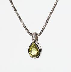 Chrysoberyl pendant with diamonds.