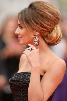 Cheryl Cole - sleek twisted up do with straight side fringe and big backcombed volume on top