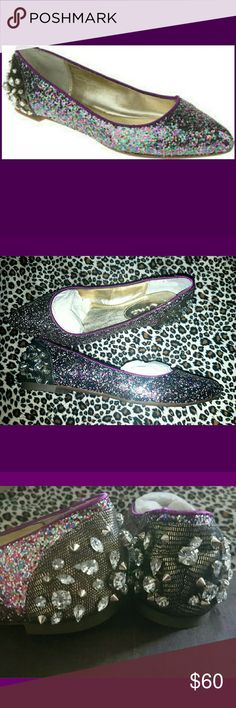 OMG!! These Shoes Are So Unique? These beauties are a multi-color purple, glittered flat. They have a nice non-skid sole.The back of the shoe is the best part, look at those awesome studs and bling! So unique, they really are a must have!  New in box, 2 available,  Ladies size 6.5 Nina Shoes Flats & Loafers