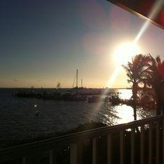 Sun is setting at Captain Hiram's in Sebastian, FL