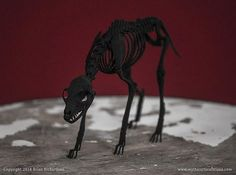 This is a digitally sculpted, 3D printed replica of a Black Shuck Skeleton. It measures 5.88 inches long by 1.725 inches wide by 3.5 inches