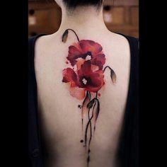 Brush stroke floral tattoo