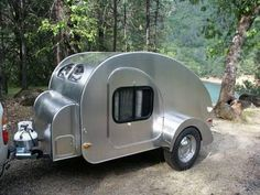 Compact custom-built teardrop-shaped travel and camping trailers. Photos and pricing. Parts and accessories. Necedah, Wisconsin.