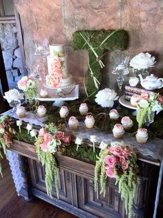 Floral cake table, dripping with gorgeous greenery and pink flowers. And of course, a moss monogram!