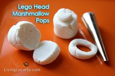 Lego Head Marshmallow Pops Cut the bottom off of a marshmallow and then use and icing tip to cut a circle out of it. Then put it, sticky side down, on top of another marshmallow. Push a lolly pop stick into the bottom and dip into your melted yellow chocolate. Finally add a face with icing.