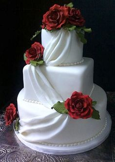 """Fully-blossomed roses, fondant """"fabric"""" and seed-pearl piping all  demurely whisper """"simple sophistication!"""""""