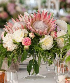 Romantic Flower-Filled Tuscan Wedding Protea and garden rose centerpiece: www. Protea Wedding, Floral Wedding, Wedding Bouquets, Wedding Flowers, Protea Centerpiece, Rose Centerpieces, Wedding Flower Arrangements, Floral Arrangements, Protea Flower