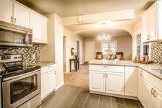 Traditional Kitchen with St. Cecilia Rio Granite, Daltile Coastal Keystones Sunset Cove 2x1 Brick Joint Mosaic