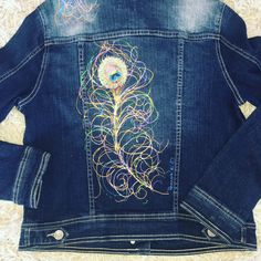 Dark denim jacket with hand painted peacock feather on back. Each piece is signed by artist and copy righted, truly a gem! One of a kind piece of art! Runs small, size Small is S/M, size L is M/L.