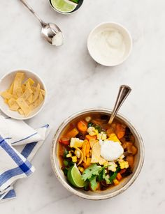 Butternut Squash Black Bean Chili | Love & Lemons | A hearty spicy vegetarian chili that's perfect for weeknights, game day, or make-ahead lunches. It's SO delicious topped with vegan poblano cashew cream. Vegan, gluten free.