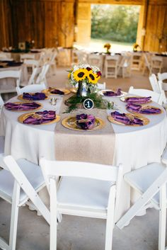 White linens and folding chairs with burlap table runners, gold charger plates and berry napkins.  Sunflower Inspiration at The Barn at Williams Manor