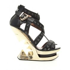 Taunt Black and Gold Heel-Less Wedge Sandal - New at GothicPlus.com Price: $148.95  Unique and cool these heel-less style open wedge sandals have open sides with T-strap front and zipper back. Criss cross straps are accented with lots of rivets for a gothic edge.  The heel is 5 inches platform 1 1/2 inches in molded ABS.  Made by Hades Shoes with eco-friendly man-made materials padded insole and non-slid sole  #gothic #fashion #steampunk