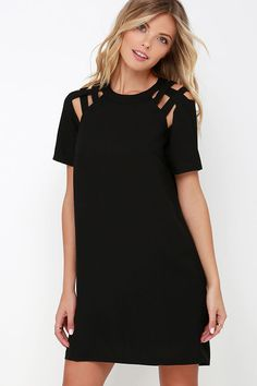 When you're on your way out the door and need the perfect dress for a busy day, you'll be grateful the Shoulder Shrug Black Shift Dress is in your…