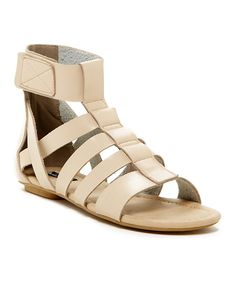 Take a look at this Michael Antonio Natural Darris Gladiator Sandal today!