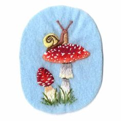 Hand embroidered sew-on patch Find it at BUST's Craftacular in May!