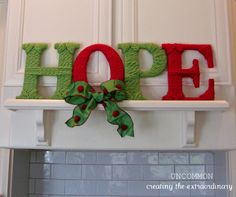 HOPE Yarn Letters...i did this by cutting out letters from an old cardboard box and then wrapping them in yarn. Looks great on the very top of the kitchen cabinets