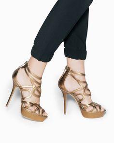 Gold platform high heeled sandals