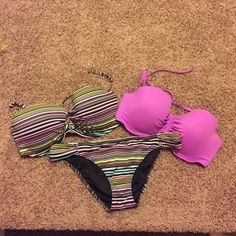 VS Bikini Bundle Tops:Molded push-up padding Underwire; side boning for support Removable halter strap Adjustable back clasp closure Lined In smooth matte fabric Imported nylon/spandex. Bottoms (L) are normal coverage with rousched sides and sits low on waist. Mix & Match! Everything is in excellent condition. No stains snags or piling. Hang to dry. Wash on gently cycle. Victoria's Secret Swim Bikinis