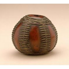 Shona peoples Tsonga peoples Zulu peoples Snuff container Date: Late 19th-early 20th century Medium: Gourd, brass wire Dimensions: H x W: 5.7 x 7 cm | National Museum of African Art