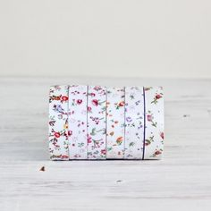 This lovely floral fabric tape is wonderful to use for all kinds of wrapping and crafting! One side is fabric and the other side is adhesive with a...