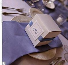 One of the key style motifs of the day was a monogram and ribbon theme. Brooke had spotted CD cases on TheKnot.com that were wrapped in ribbon with a square monogram closure. She incorporated a similar look into the invitations, programs, welcome baskets,...