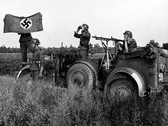 Waffen SS soldiers in Horch 901 vehicle, with MG 34.