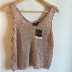 TOPSHOP sweater Brand new with tag TOPSHOP sleeveless sweater. Topshop Sweaters V-Necks