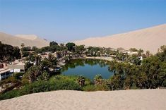 Huacachina Oasis - Peru / Huacachina is a small oasis town in the Ica region of southwest Peru. This oasis, named 'Oasis of Americas', is a popular resort with local families and tourists.