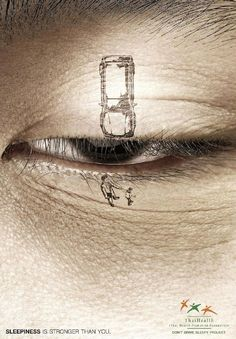 The drooping eyelid and drawings of car and people makes the hook immediate.